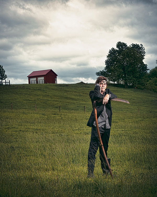 """Drew HAstings photographed in late May on the land that inspired the material for his """"Farmageddon"""" comedy tour."""