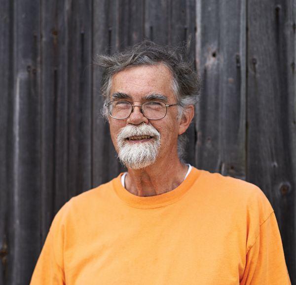 Volunteer Gordon Allen is part of a team that performs controlled burns around the restored prairies.