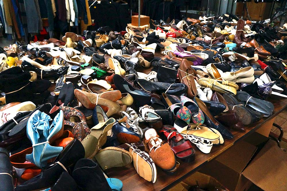 A table full of women's shoes