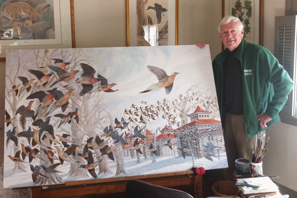 Ruthven in his Georgetown studio with his painting Martha, the Last Passenger Pigeon