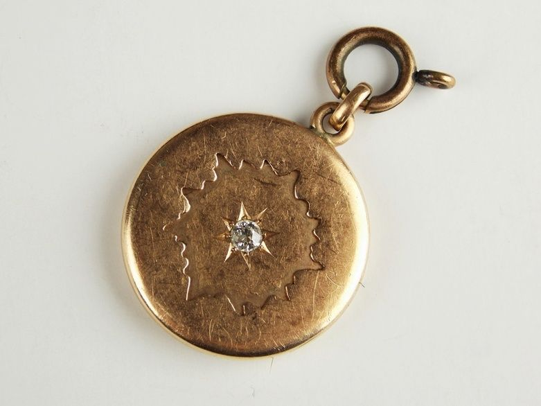 An Antique 10K Rose Gold Locket with Diamond and Lock of Hair