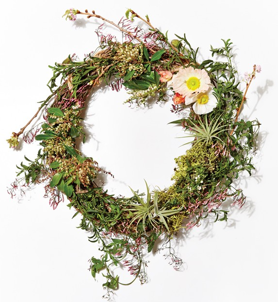 Wreath of jasmine vine, cherry blossoms, and Icelandic poppies by Fern.