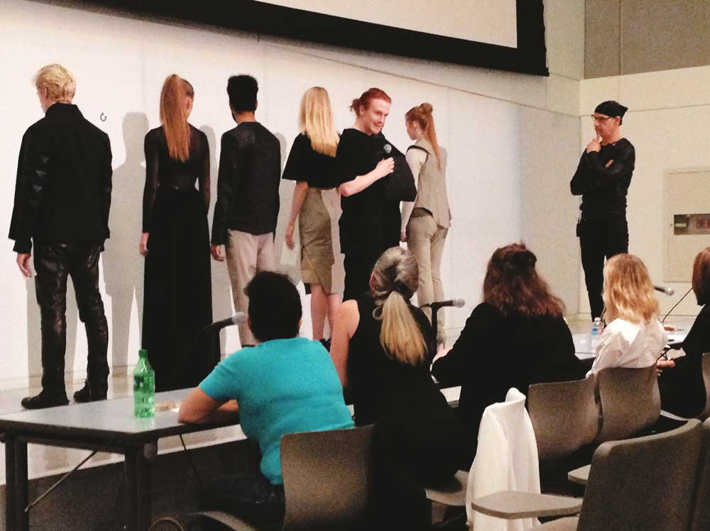 Connor Devoe's models show the judges the back view.