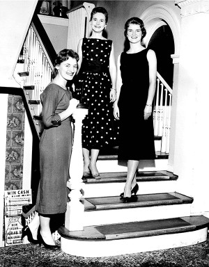 In 1958, a trio of residents smile on the stairs.