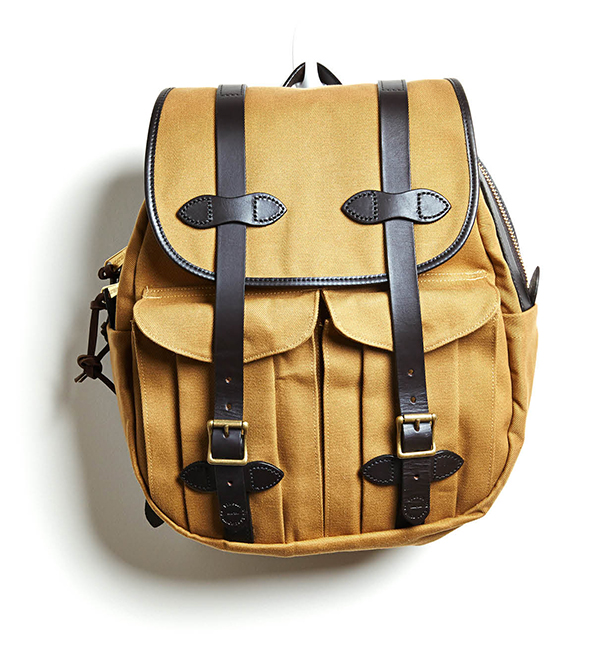 QUITE STRAPPING Go ahead, check-in online: Filson's sturdy, water-repellent rucksack is fit to fly as a carry-on. $290, Delamere & Hopkins, delamereandhopkins.com