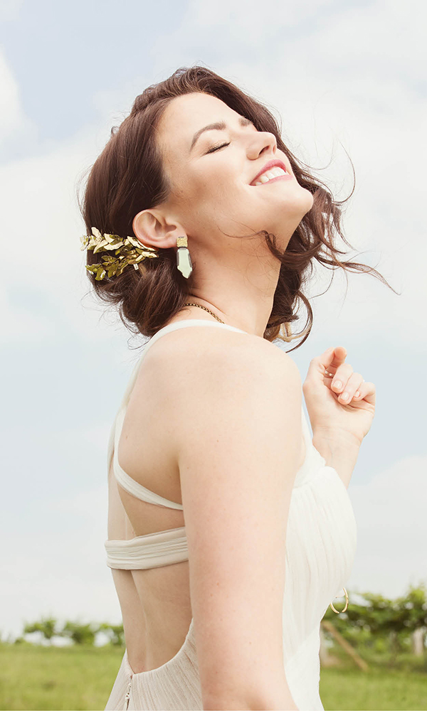 Vera Wang gown, $4,990, Bridal and Formal. Jennifer Behr Eos comb, $287.50, J.Crew. Enamel and reticulated brass earrings, $140, Hannah Hoffman. Agate Crescent necklace, $70, Rock Salt Vintage.