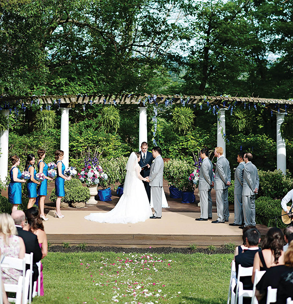 On June 7, 2014, Tricia and Michael hosted a classically elegant celebration, with shades of blue and purple, towering floral arrangements, and live music, amid the wide open spaces and dramatic art displays at Pyramid Hill Sculpture Park.