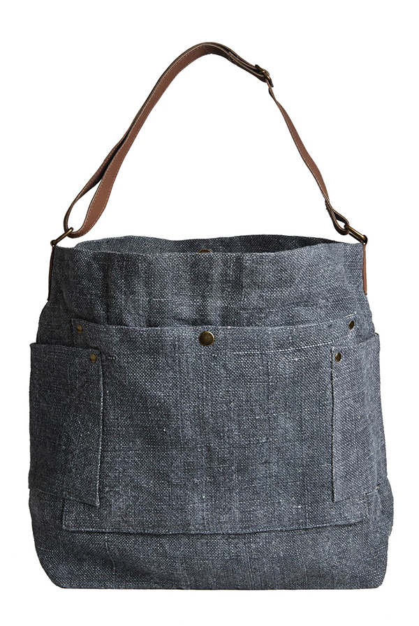 DIVIDE AND CONQUER A more-subtle take, this soft, lined linen and leather tote is surprisingly spacious. Plus: All those pockets. Poketo washed linen tote, $66.50, poketo.com (we found ours at MiCA 12/v)