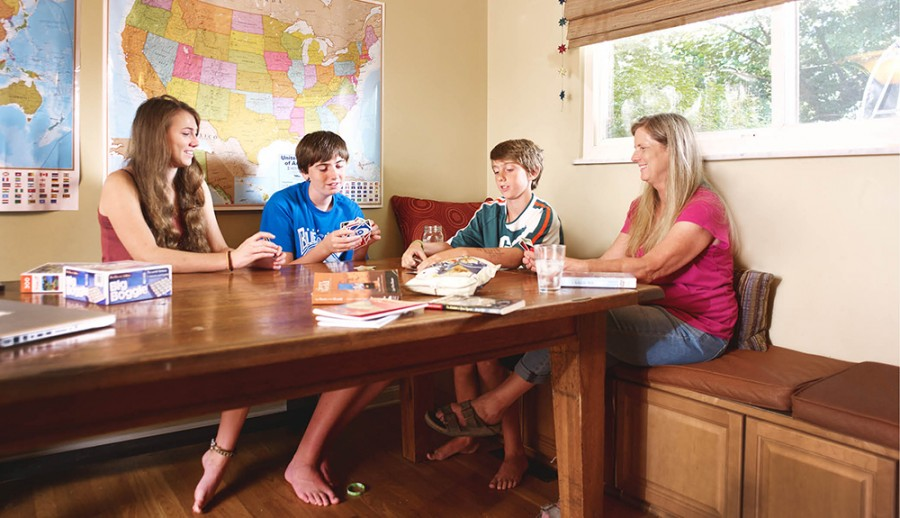"""At their home in Blue Ash, Abby, Iain, and Owen Ruehlman-Walsh are involved in the process of unschooling—in this case, a game of cards with their mother, Cathy Ruehlman. """"I feel like you only really learn something if you're interested,"""" says Cathy."""