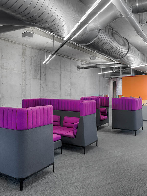 Tall-backed chairs double as intimate conference spaces.