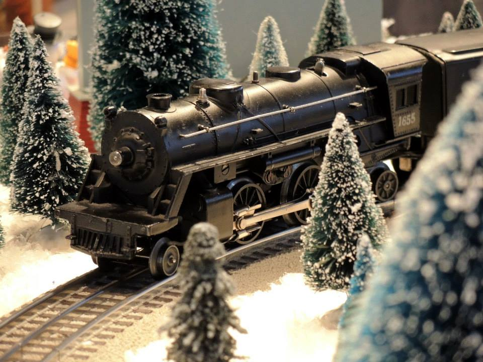One of BCM's vintage engines makes its way through a miniature, snow-covered forest.