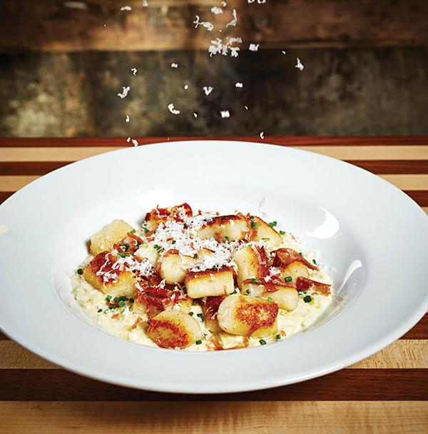 Gnocchi with leek-Parmigiano fondue and speck