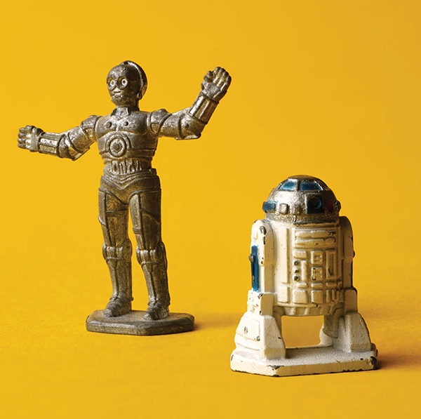 A 1983 prototype of C-3PO (never released) alongside a 1982 production sample of R2-D2