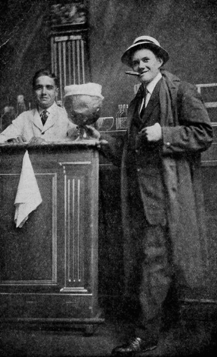 """""""The President of the Senior Class"""": Young man with a big pot of beer, smoking a cigar, from the 1914 Cincinnatian, the yearbook of the University of Cincinnati"""