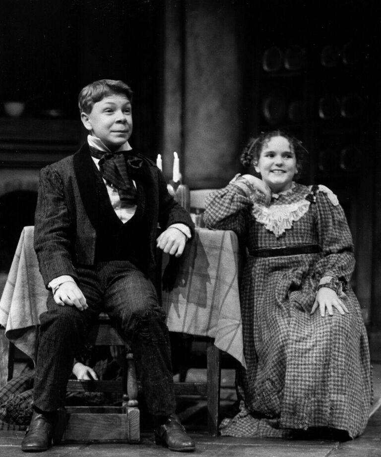 Andrew Chaney (Peter Cratchit, left) and Kristen Schwarz (Belinda Cratchit, right) in the 1995 production.