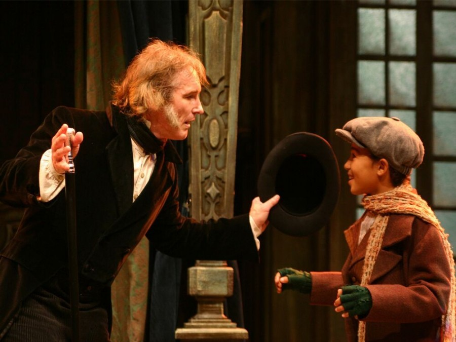 Bruce Cromer (Ebenezer Scrooge, left) practices his social graces with Christian M. Spaulding (George) in the 2007 production.
