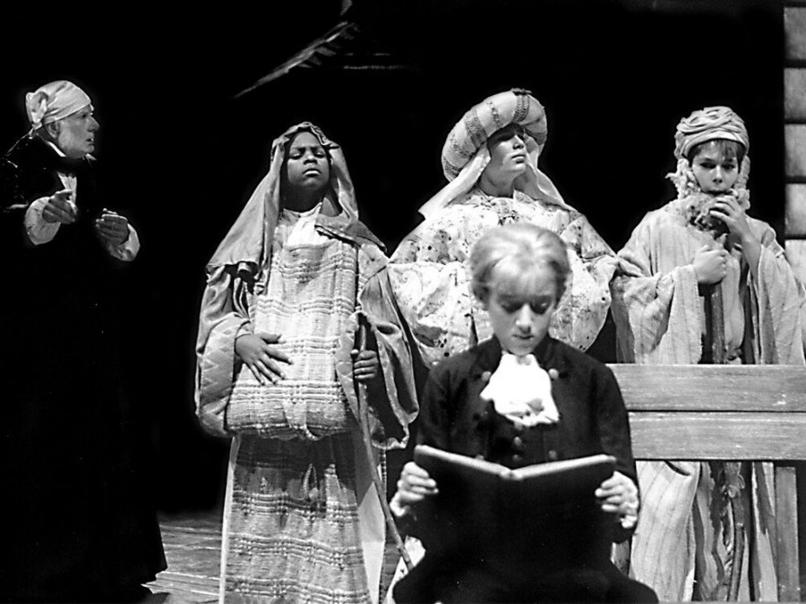 Joneal Joplin (Ebenezer Scrooge, left) observes his former classmates and his younger self in the 2001 production, left to right: Aaron Mayo (Charles), Dustin M. Hicks (Gregory), A.J. Grubbs (Boy Scrooge, foreground), and Nathan Wallace (Matthew).