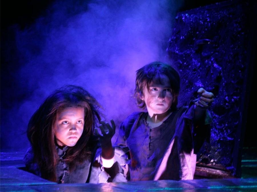 In the 2012 production, Ignorance (Joseph Forest Lennon Hamzy, right) and Want (Aubrey Elizabeth Jones, left) confront Ebenezer Scrooge.