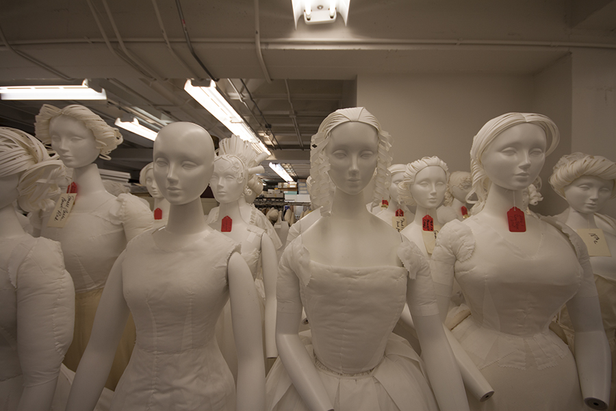 Amneus and her team outfit mannequins with undergarments to support various styles and silhouettes and hand-build paper hairdos.