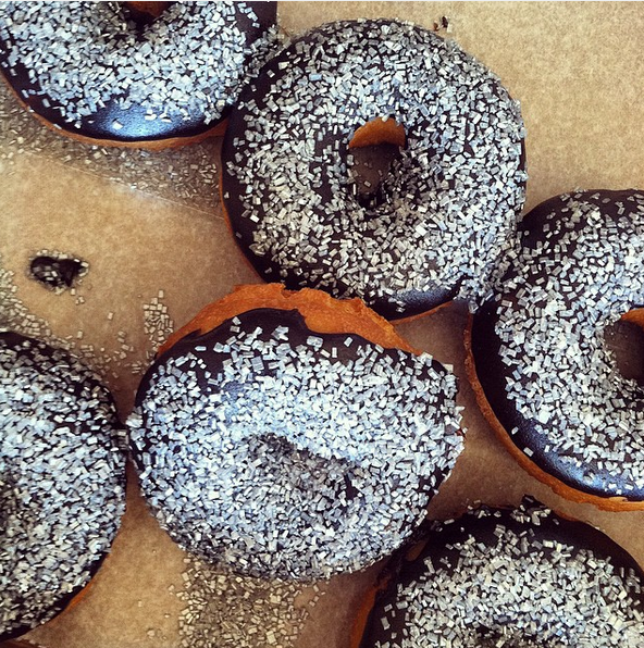 Ever had edible glitter? Frosted donuts from Top This Donut Bar are tasty with or without extra bling.