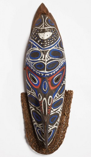 """Ceremonial wooden mask of the Biwat people of Papua New Guinea. The double-faced masks weren't worn as costume pieces but """"to represent a different reality,"""" says Bob Genheimer."""