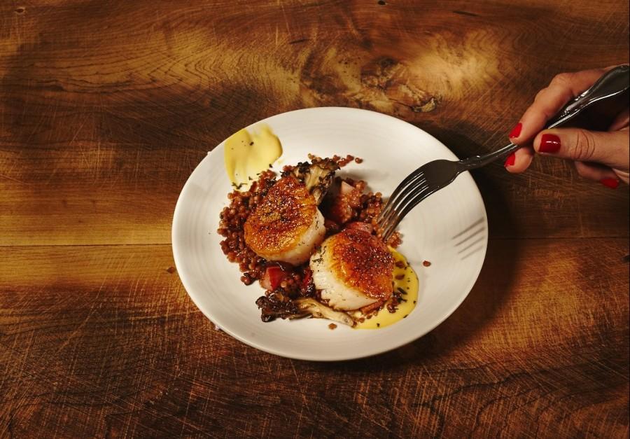 Scallops, maftoul, roasted mushrooms, bacon, and smoked egg vinaigrette