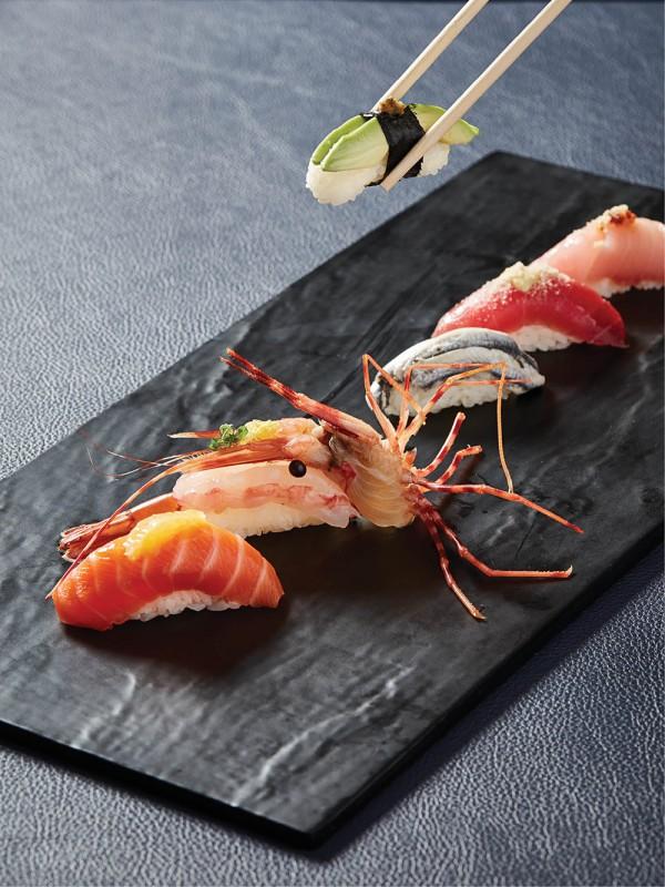 A lineup of nigiri sushi.