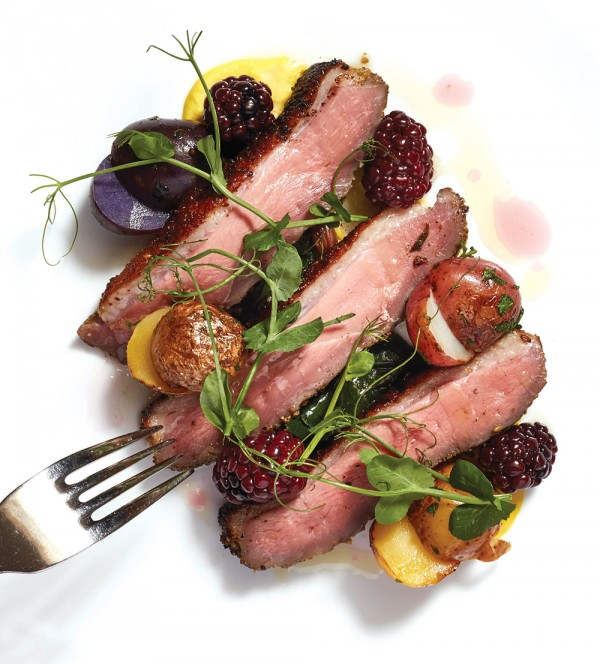 Grilled duck breast with marble potatoes and blackberry compote at Metropole.