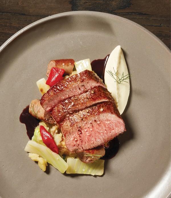 Cordero Al Ajillo: Lamb loin, pequillo peppers, fingerling potatoes, Merguez sausage, and fennel soubise