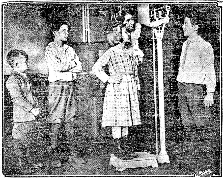 Ella Walsh, who started the first school lunch program in the United States, weighs pupils in the 1919 Cincinnati Post photograph. Students in the photo are Joe Gorman, Edward Hodges, Margaret McGurk, and Alexander Hess.