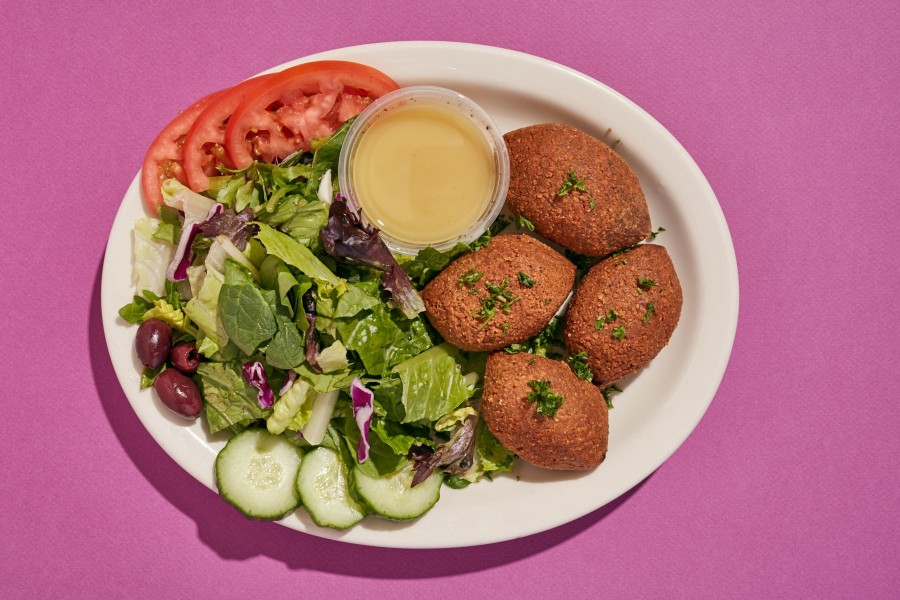 Kibbie plate: croquettes filled with seasoned beef, bulger, onions, and roasted pine nuts
