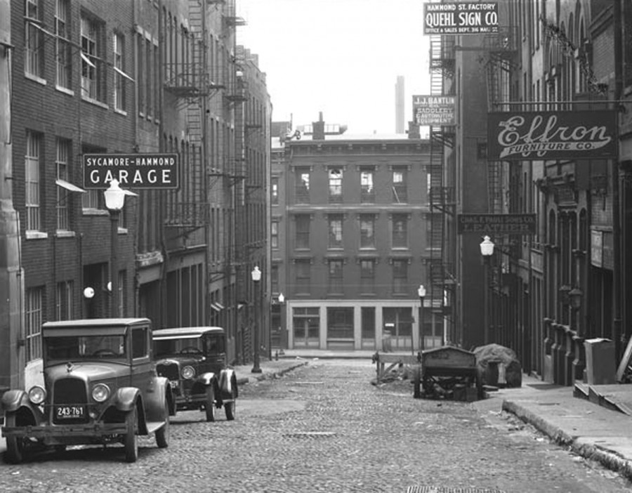 """Viewed from Hammond Alley in 1928, the structure once known as the """"Law Building"""" still stood on the south side of Third Street. When this photo was made, the building housed the offices of several distilleries and a warehouse full of """"medicinal"""" liquor."""