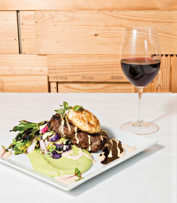 Market-priced, local New York strip steak topped with a crab cake.