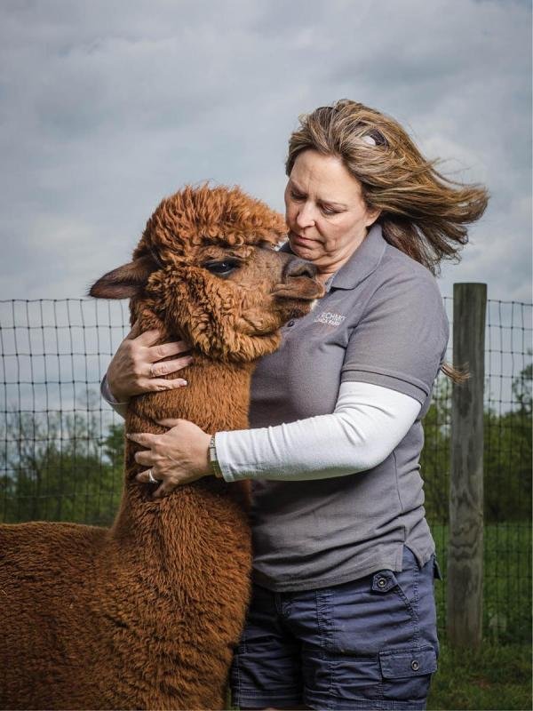 Lori Wahl with one of the herd