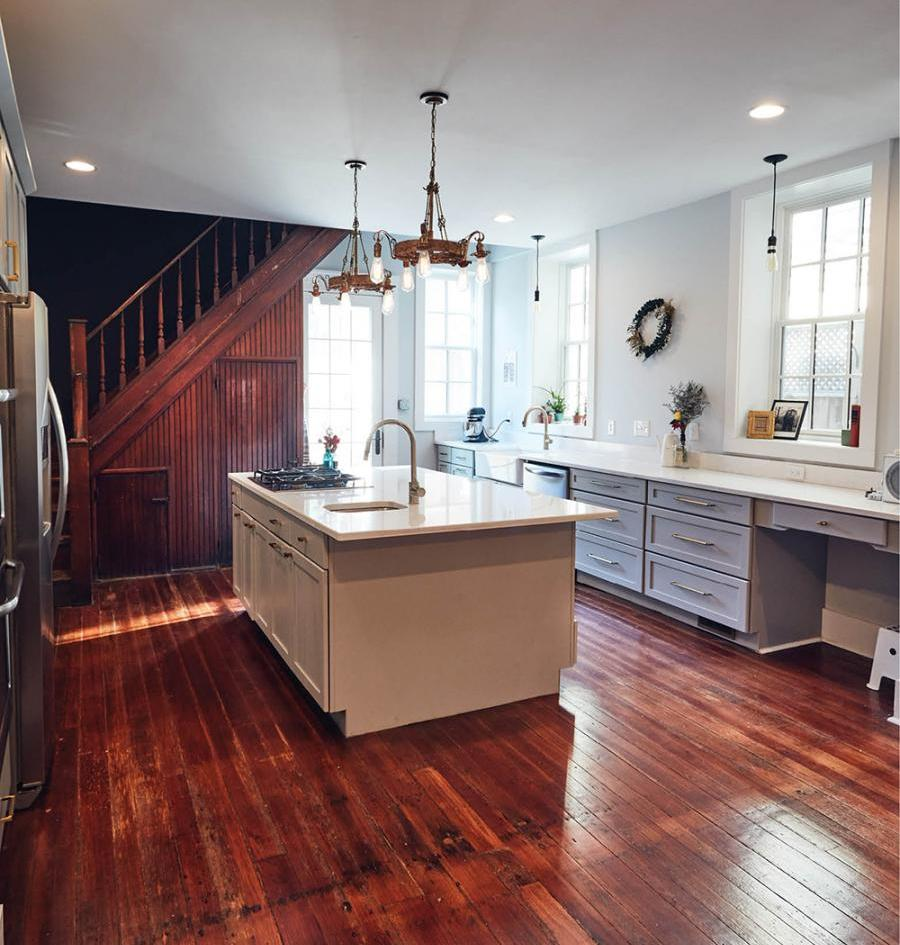 The Von Allmens designed the spacious kitchen pairing original hardwood flooring with new quartz countertops and cabinetry from Profiles in Design.