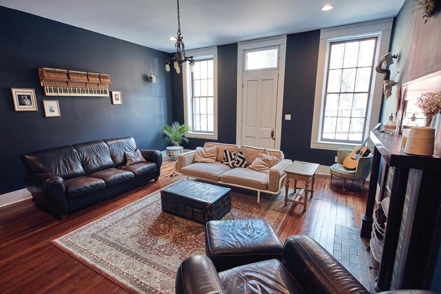 Contemporary furnishings mix with Victorian-era lighting in the living space.