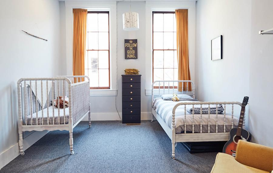 """The kids' bedroom suite. Sherwin-Williams's """"Reflection,"""" a shade of light gray, is used throughout much of the interior space."""