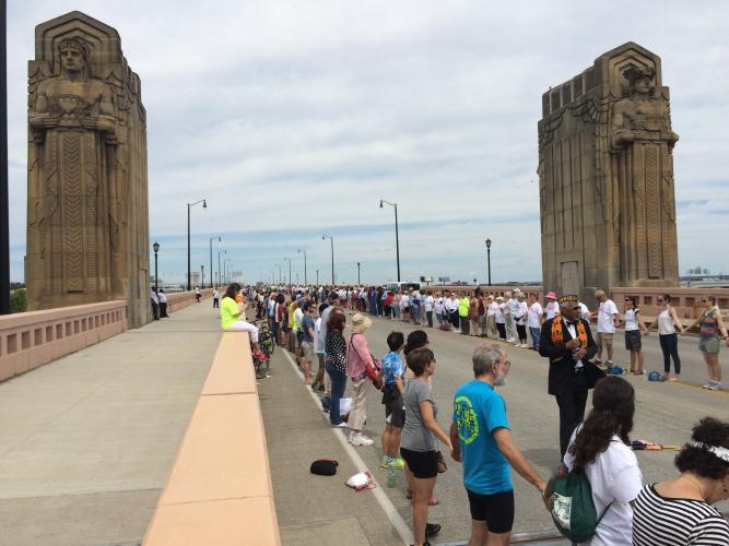 """A moment from Sunday's """"Circle the City With Love"""" rally on the Hope Memorial Bridge."""
