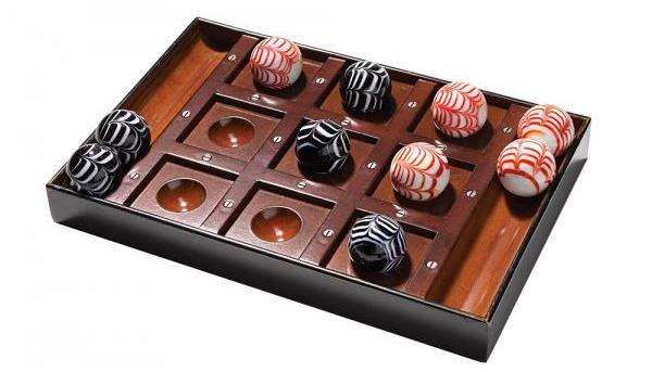 Leave the pen and paper to the hoi polloi and go for this classed-up version of Tic-Tac-Toe. The cherry wood board and Murano-style glass balls pair well with a glass of burgundy—or a cold brew. Authentic Models Venetian Tic-Tac-Toe game, $100, Bromwell's, bromwells.com