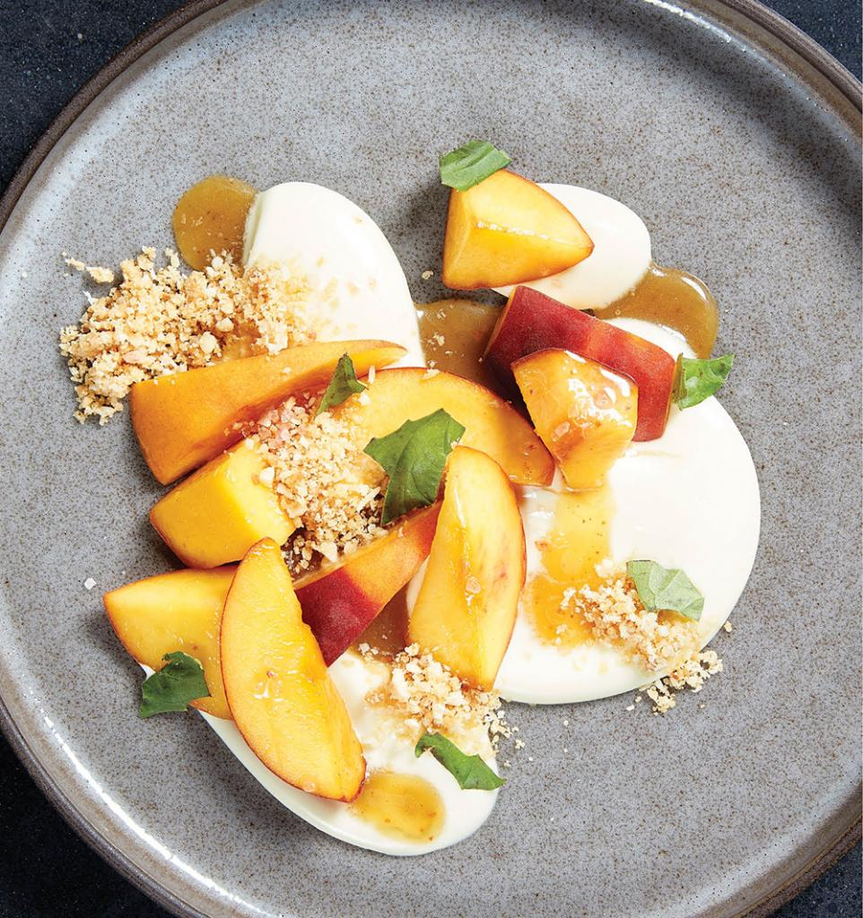 Pleasantry's peaches and cream dessert, with coconut, almonds, and brown butter honey