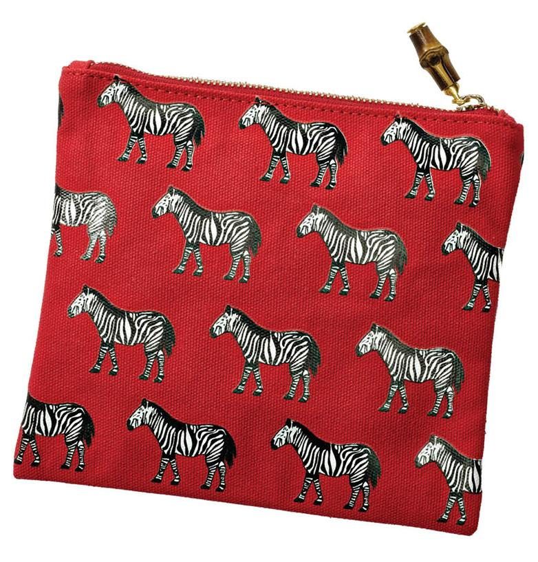 What's black and white and read all over? This cosmetics bag. Don't settle for basic florals when you can have a march of the zebras in your purse or bathroom instead. Flat Canvas Cosmetic Bag, $20, Anne Rice Limited, (513) 271-3020