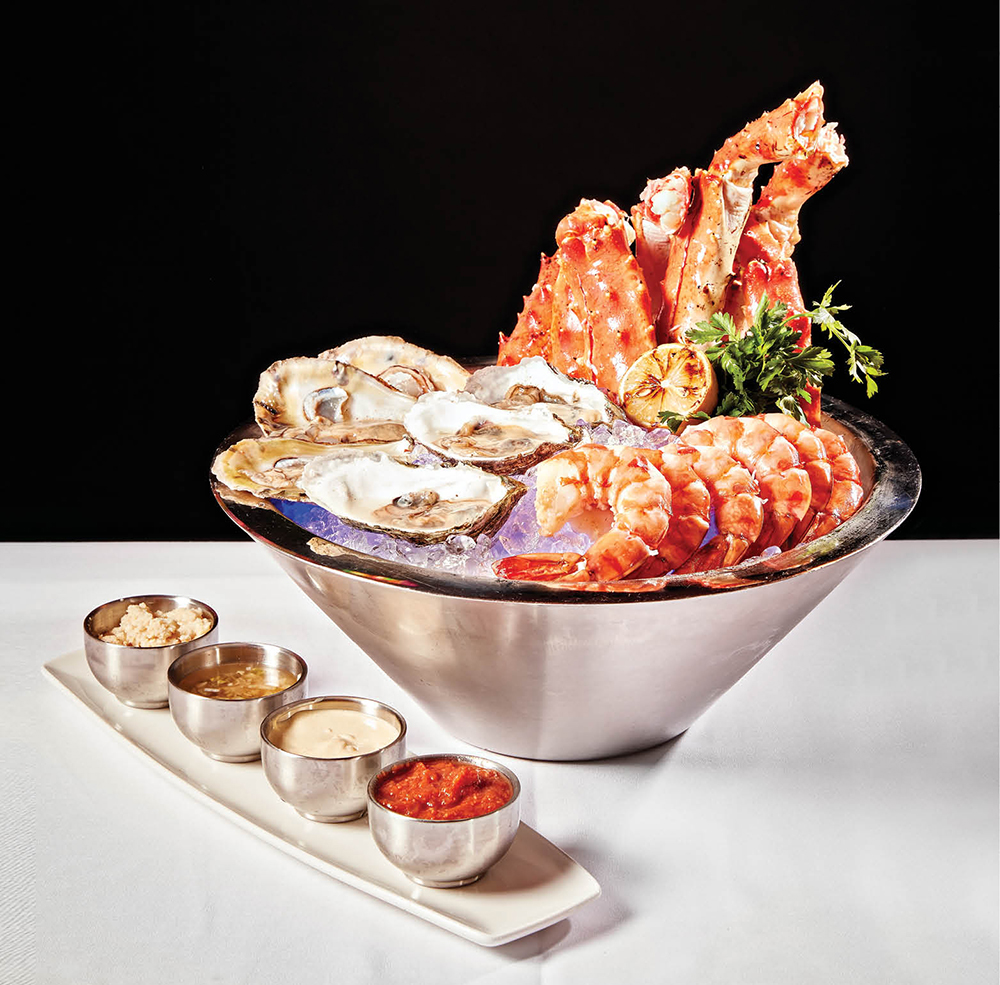 Treats from the raw bar - shrimp cocktail, Alaskan King crab, and domestic oysters