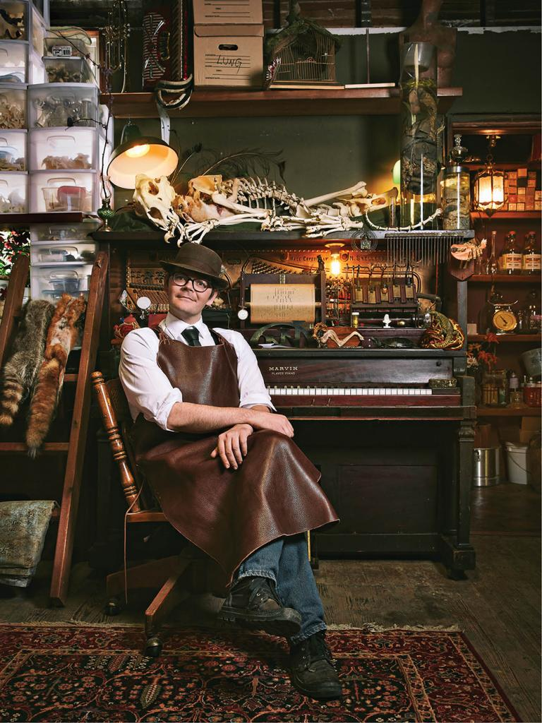 Jeremy Johnson, photographed in the Meddling with Nature workshop, in front of a Marvin Player Piano from the early 1900s.