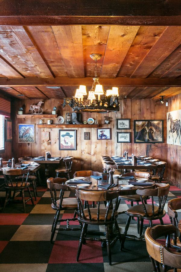 View of the Cowboy Room with artwork honoring famous cowboys