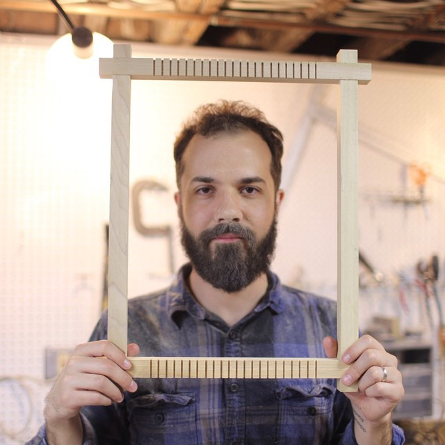 Billy Otten with a homemade wooden loom