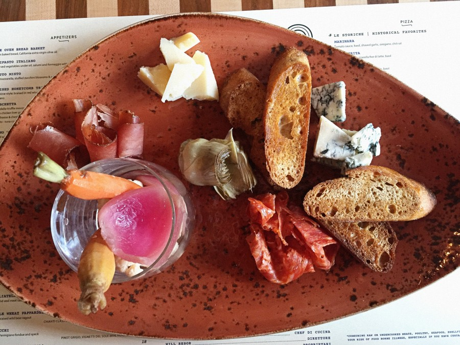 Antipasto Italiano with preserved vegetables under oil, salumi, and formaggio with crostini