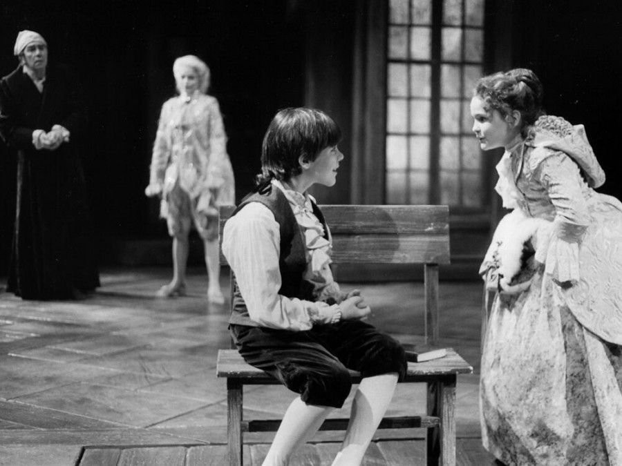 Michael Ingram (Boy Scrooge, center) with Kristen Schwarz (Fan, right) in the 1993 production. Background: Alan Mixon as Ebenezer Scrooge, left; Dorrie Joiner as Ghost of Christmas Past, second from left.