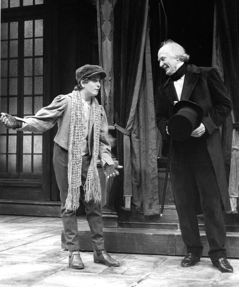 In the 1997 production Sam Rosenthal (left) portrayed George and Joneal Joplin (right) took over the role of Ebenezer Scrooge.
