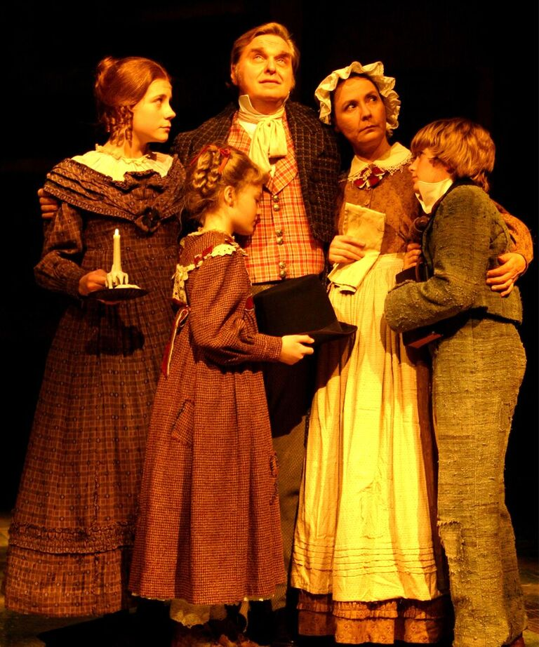 The Cratchit family in the 2005 production, left to right: McKenzie Miller (Martha Cratchit), Jo Ellen Pellman (Belinda Cratchit), Andy Prosky (Bob Cratchit), Regina Pugh (Mrs. Cratchit), and Cullen Cornelius Arbaugh (Peter Cratchit).