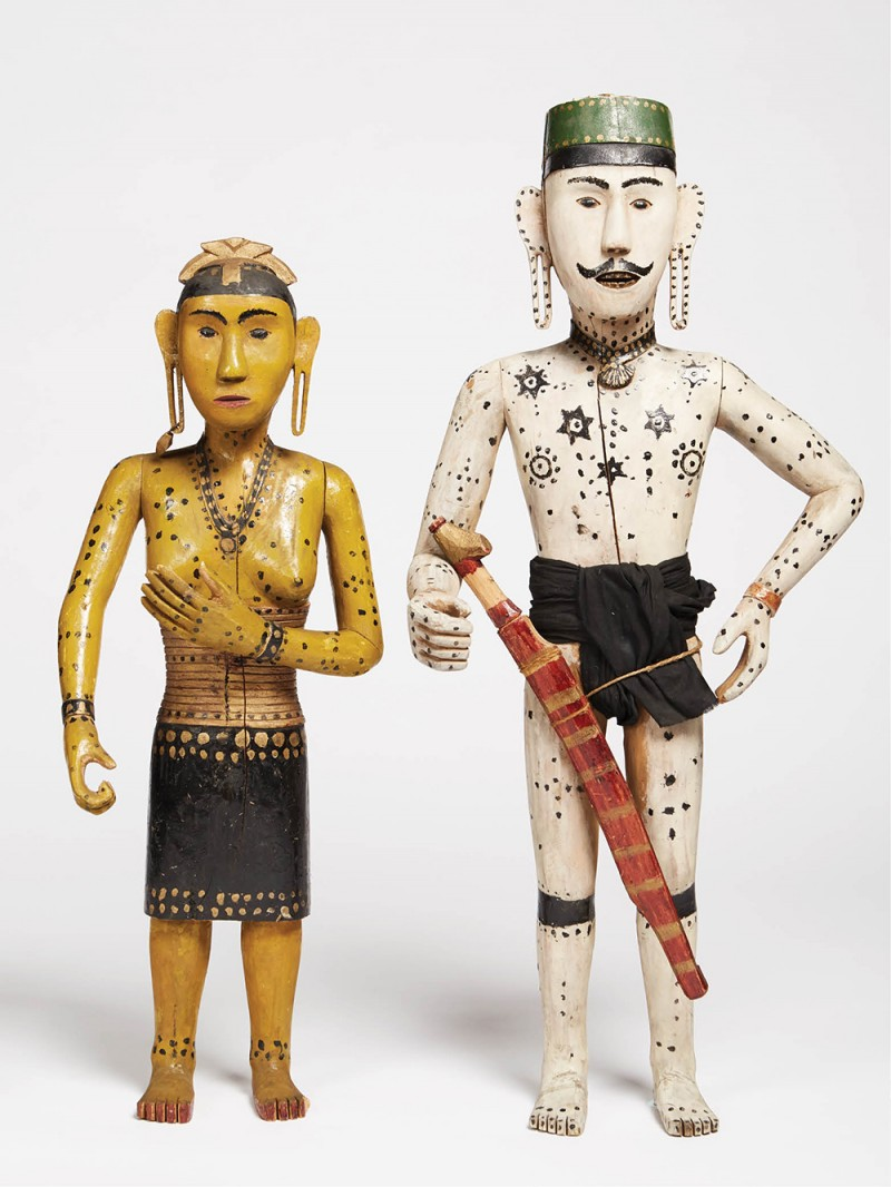 Wooden wedding dolls from the Sarawak region of Malaysia. The bride and groom once held items that were lost before they were donated to the museum's collection.